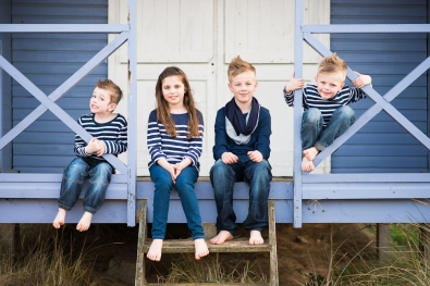 COUSINS PORTRAIT ON BEACH HUT VERANDA NORFOLK