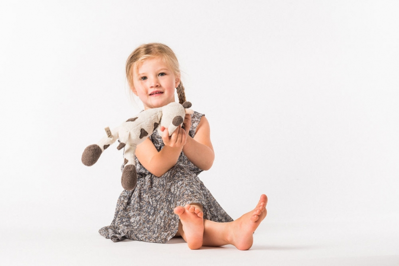 GIRL AND SOFT TOY