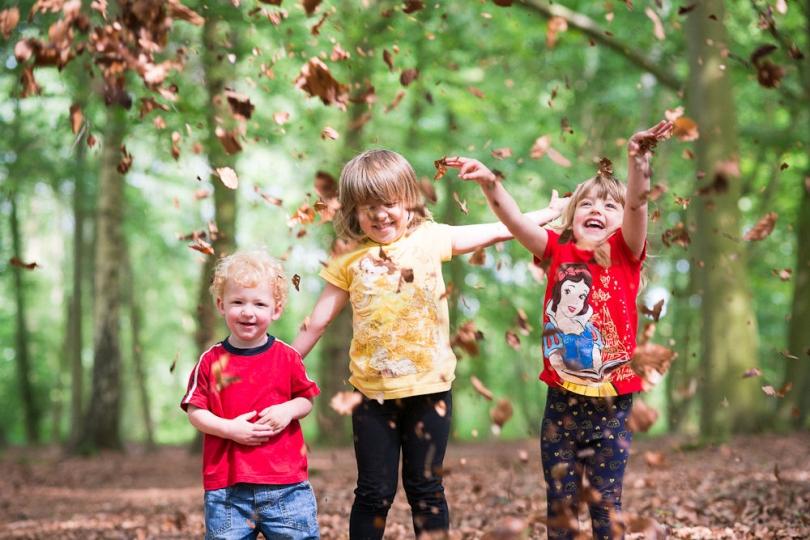 KIDS PLAYING PHOTOGRAPH NORWICH WOODLAND