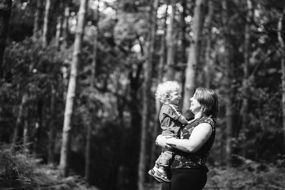 MOTHER AND SON BLACK AND WHITE IN THE WOODS