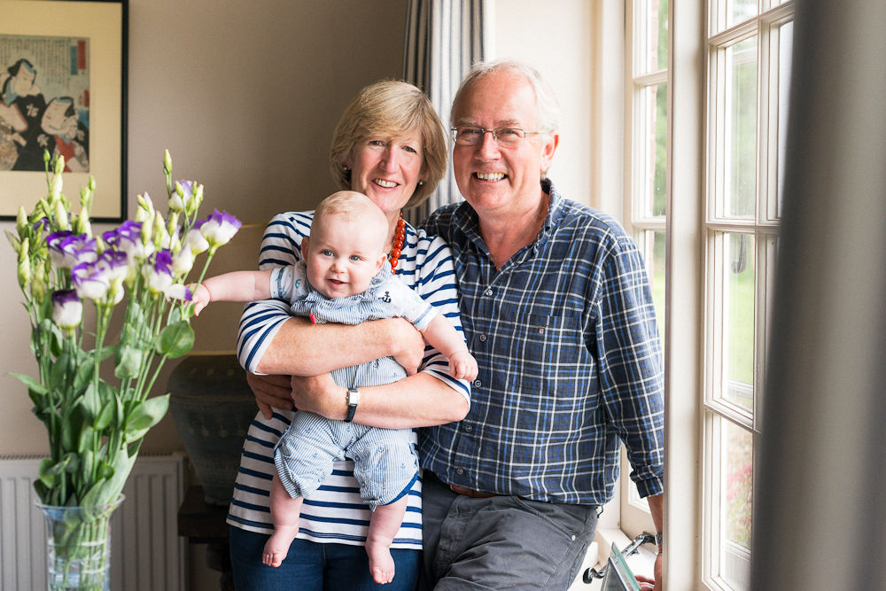 PROUD GRANDPARENTS AND SMILING BABY