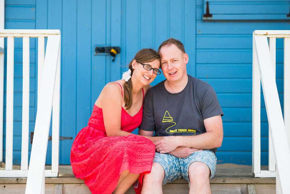 MUM AND DAD SITTING ON A BEACH HUT STEP