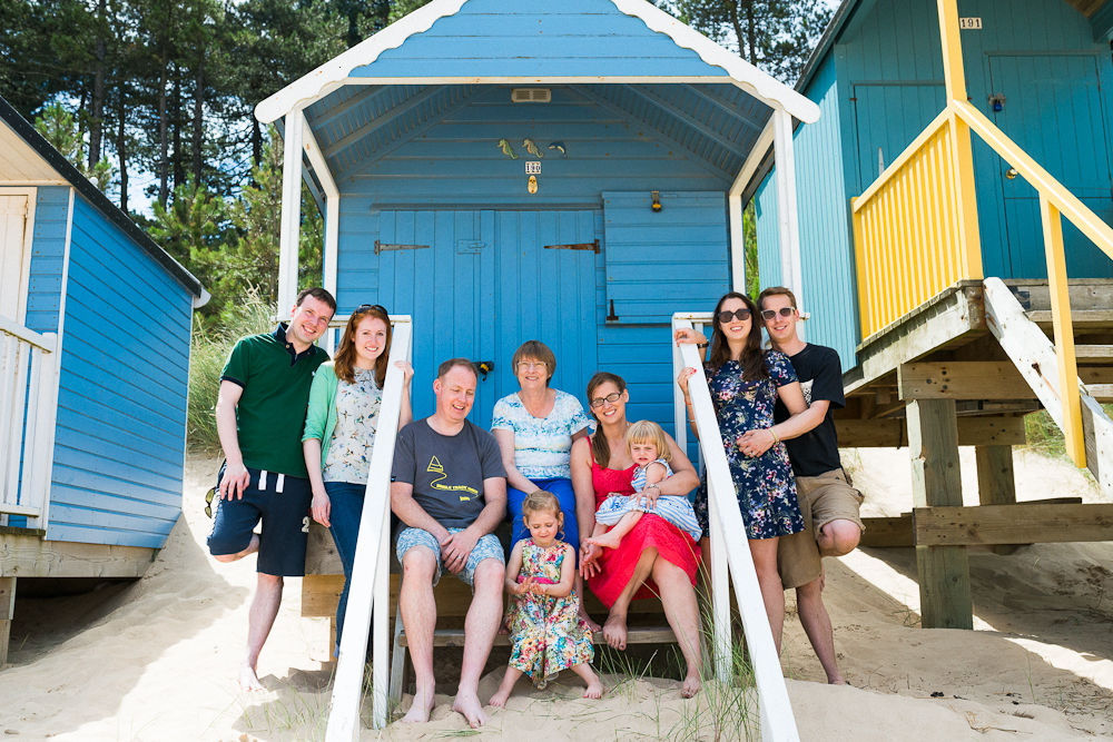 FAMILY PORTRAIT BESIDE THE BEACH HUT