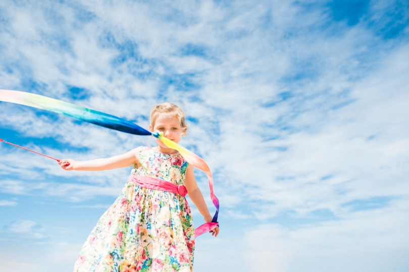 BLUE SKY AT THE NORTH NORFOLK BEACH AND GIRL