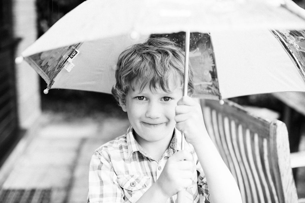 BOY AND HIS UMBRELLA PHOTOGRAPH