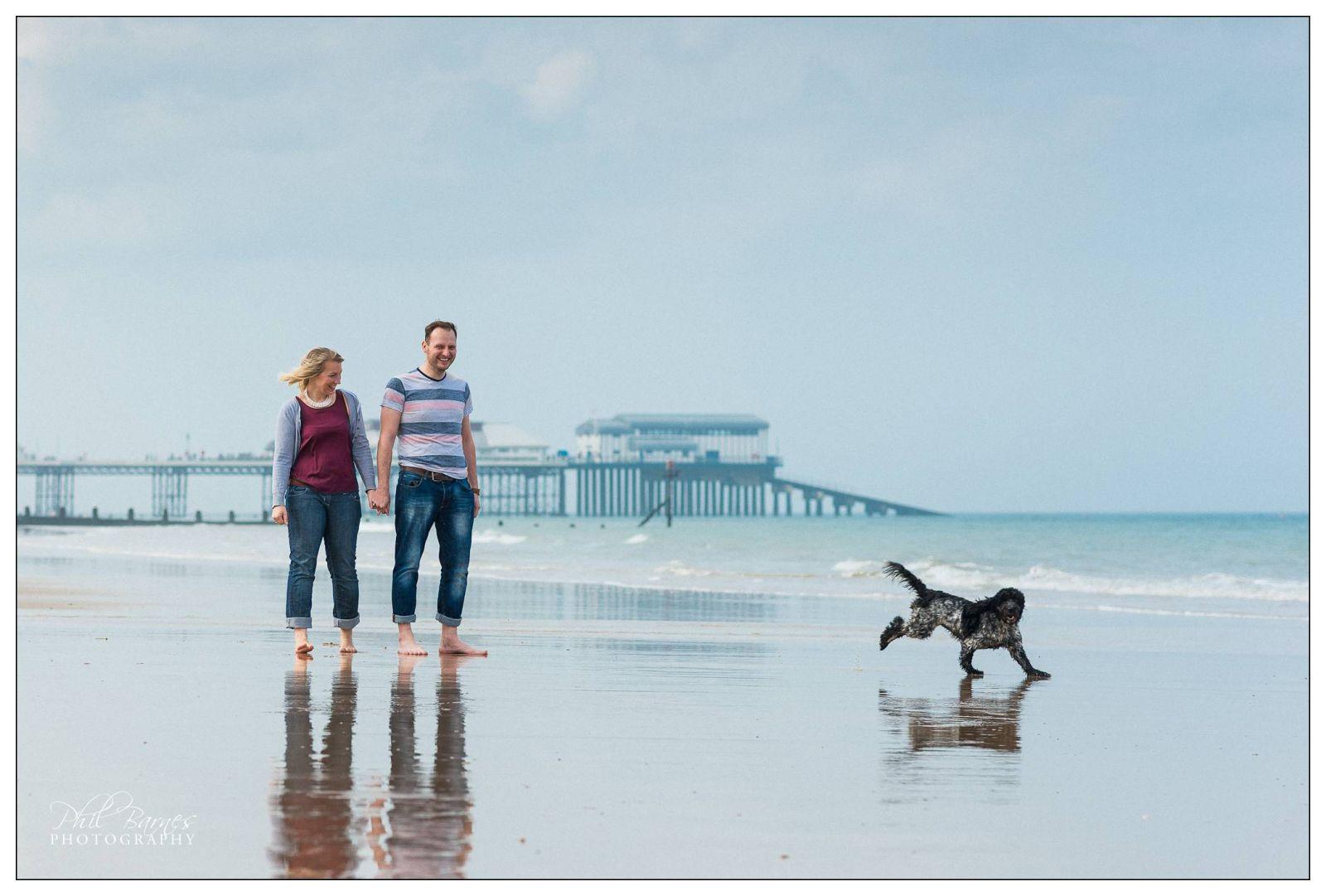 COUPLE AND THEIR DOG CROMER BEACH PORTRAIT