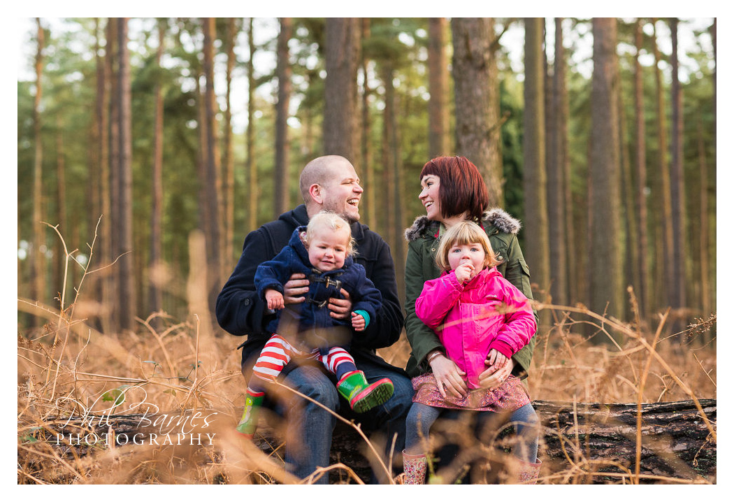 family seated portrait amongst bracken